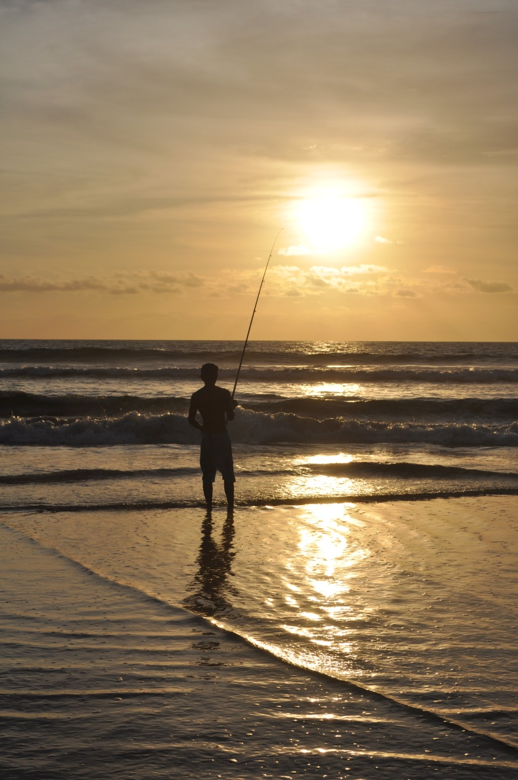 Fisherman at sunset in Bali